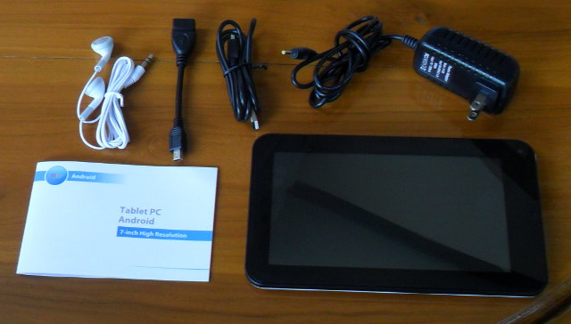WM8850 tablet, power supply, headphone, USB cable and manual