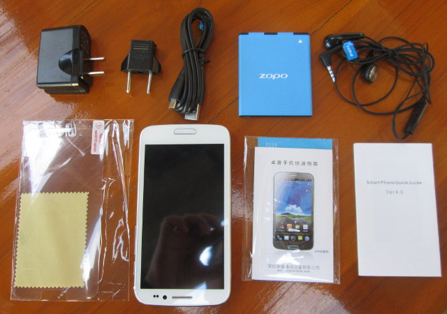 Mediatek MTK6577 Smartphone with power adapter, cables and battery