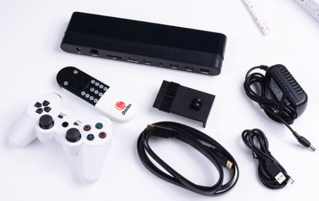 Pandora TV Box with its remote, game controller, power supply, and cables.