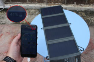Foldable Solar Charger Charging Smartphone